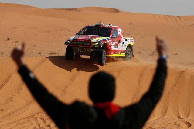 Orlen Benzina Team's Martin Prokop and Co-Driver Viktor Chytka in action during stage 6 as a person cheers, Al Qaisumah to Ha'il, Saudi Arabia on January 6, 2021. (Photo by Hamad I Mohammed/Reuters)