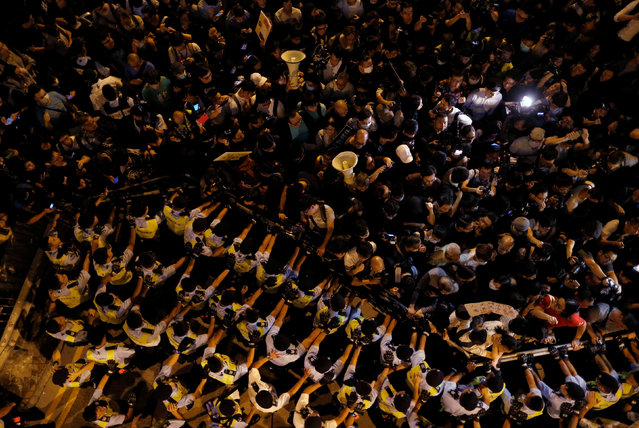 Police stop demonstrators as they protest against what they call Beijing's interference over local politics and the rule of law, a day before China's parliament is expected to announce their interpretation of the Basic Law in light of two pro-independence lawmakers' oath-taking controversy in Hong Kong, China November 6, 2016. (Photo by Tyrone Siu/Reuters)