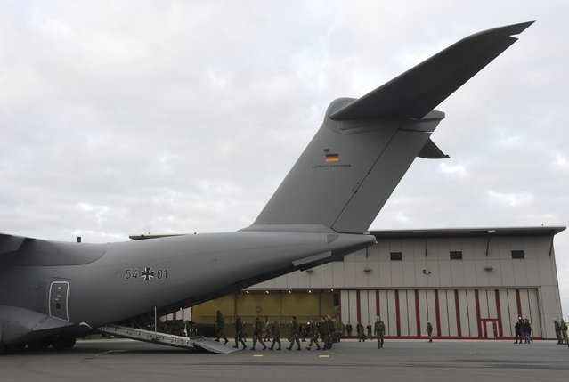 Army personnel board a German airforce Airbus A400M military aircraft at German army Bundeswehr airbase in Jagel, northern Germany December 10, 2015. (Photo by Fabian Bimmer/Reuters)