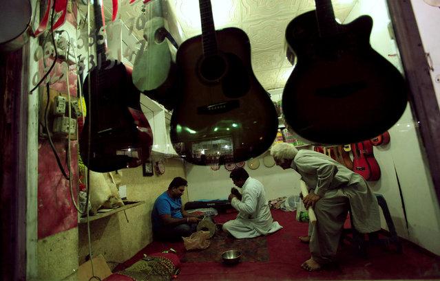 Men repair a traditional drum at a shop in Rawalpindi, Pakistan, October 19, 2016. (Photo by Faisal Mahmood/Reuters)