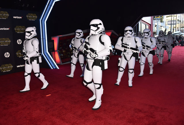 "Stormtroopers march on the red carpet at the world premiere of ""Star Wars: The Force Awakens"" at the TCL Chinese Theatre on Monday, December 14, 2015, in Los Angeles. (Photo by Jordan Strauss/Invision/AP Photo)"