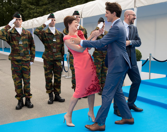 Belgian Prime Minister Charles Michel, his partner, Amelie Derbaudrenghien, and Canada's Prime Minister Justin Trudeau during the arrival for a dinner at the Parc du Cinquntenaire – Jubelpark park in Brussels, Belgium on July 12, 2018. (Photo by Benoit Doppagne/Pool via Reuters)