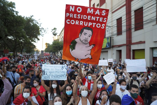 Youth protests against the government of President Mario Abdo Benitez in response to the shortage of medications for COVID-19 patients in hospitals and the low availability of the vaccine against the new coronavirus, in Asuncion, Paraguay, Saturday, March 6, 2021. Abdo Benitez made changes in three members of his Government staff, amid the resignation of the country's health minister. (Photo by Jorge Saenz/AP Photo)