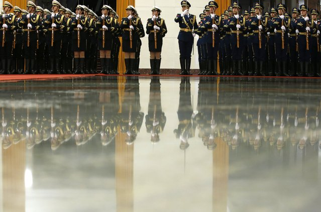 China's honour guards are reflected on the floor as they rehearse prior to a welcoming ceremony for Thailand's Prime Minister Prayuth Chan-ocha and China's Premier Li Keqiang inside the Great Hall of the People in Beijing December 22, 2014. (Photo by Kim Kyung-Hoon/Reuters)