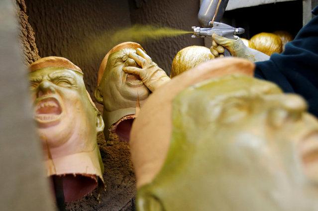 Rubber masks depicting U.S. President-elect Donald Trump are painted at the Ogawa Studios, a mask making company, in Saitama, Japan, November 21, 2016. (Photo by Toru Hanai/Reuters)