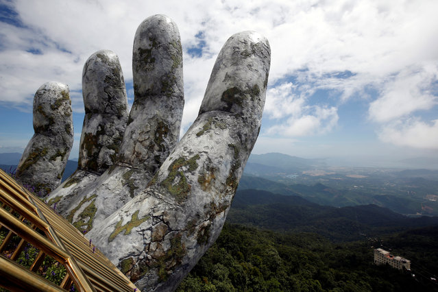 A giant hand structure at the Gold Bridge is seen on Ba Na hill near Danang city, Vietnam on August 1, 2018. (Photo by Reuters/Kham)