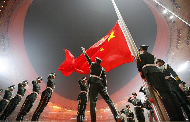 China's national flag is raised during the opening ceremony of the Beijing 2008 Olympic Games at the National Stadium in this August 8, 2008 file photo. (Photo by Jerry Lampen/Reuters)