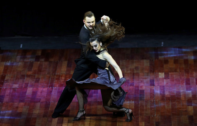 Manson Gerasimov of Russia and Agustina Piaggio of Argentina, representing the city of Rio Grande, Argentina, perform during the Stage style final round at the Tango World Championship in Buenos Aires, Argentina on August 23, 2018. (Photo by Marcos Brindicci/Reuters)