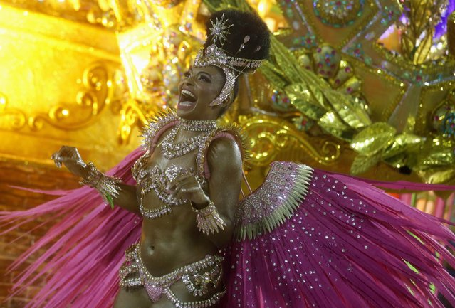 Mangueira samba school's drum queen Evelyn Bastos participates in the annual carnival parade in Rio de Janeiro's Sambadrome, February 15, 2015. (Photo by Pilar Olivares/Reuters)