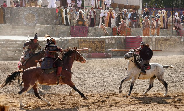 Another traditional Turkic challenge played out as jousters engaged in high-speed passes. Amid the dust-clouded chaos of the ceremony, it was sometimes hard to tell if tumbles were choreographed or painfully accidental. (Photo by Amos Chapple/Radio Free Europe/Radio Liberty)