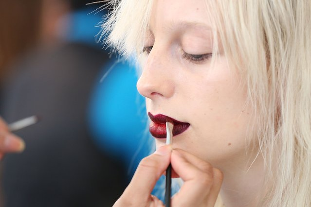 A model gets makeup applied backstage at Houghton runway show during MADE Fashion Week Fall 2015 at Milk Studios on February 16, 2015 in New York City. (Photo by Mireya Acierto/Getty Images)