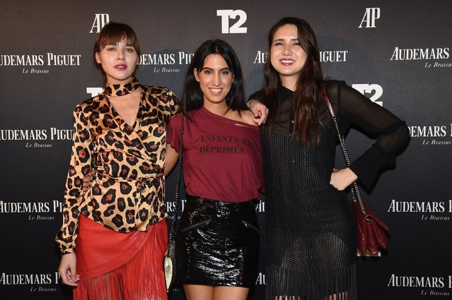 "Natalie Lim Suarez, Tania Sarin and Dylana Suarez attend the Miami Beach Kickoff Party at Audemars Piguet Art Commission ""Reconstruction Of The Universe"" by Sun Xun hosted by Take-Two Interactive at Oceanfront Miami Beach on November 30, 2016 in Miami, Florida. (Photo by Jamie McCarthy/Getty Images for Take-Two Interactive)"