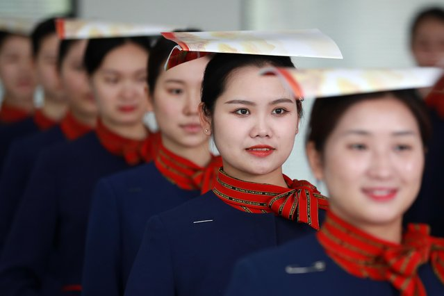 High-speed train attendants take part in a training session for the coming May Day holiday travel rush on April 27, 2021 in Wuhan, Hubei Province of China. (Photo by Zhao Jun/VCG via Getty Images)
