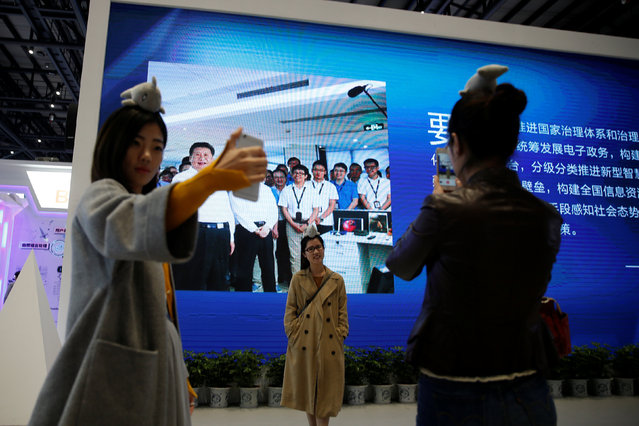 People pose for pictures during the third annual World Internet Conference in Wuzhen town of Jiaxing, Zhejiang province, China November 16, 2016. (Photo by Aly Song/Reuters)