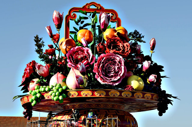 Workers install a giant vase containing fruit and flowers as part of the upcoming Chinese National Day celebrations at Tiananmen Square in Beijing on September 24, 2013. The seven-day holiday sees millions of members of China's newly wealthy and mobile middle-class travel locally and abroad. (Photo by Mark Ralston/AFP Photo)