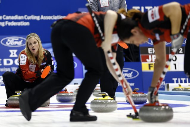 Canada's skip Jennifer Jones (L) instructs her team-mates Dawn McEwen and Jill Officer (R) as they sweep during their curling round robin game against Russia at the World Women's Curling Championship in Sapporo March 16, 2015. (Photo by Thomas Peter/Reuters)