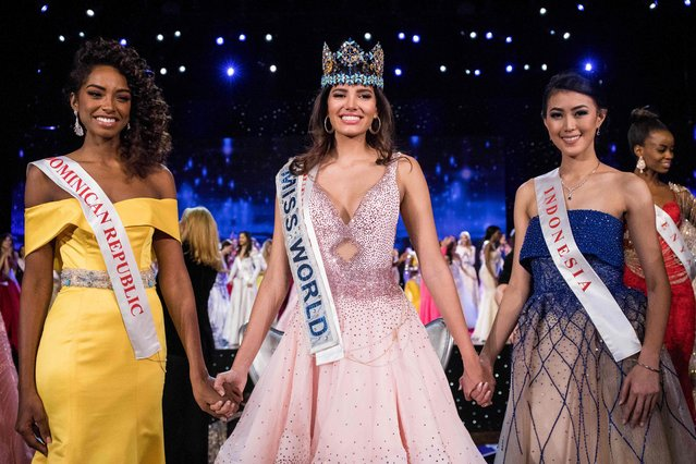 First runner up Miss Dominican Republic Yaritza Miguelina Reyes Ramirez (L); Miss World 2016 Stephanie Del Valle of Puerto Rico (C); and second runner up Miss Indonesia Natasha Mannuela (R) stand together after Del Valle's win in the Miss World 2016 pageant at the MGM National Harbor December 18, 2016 in Oxon Hill, Maryland. (Photo by Zach Gibson/AFP Photo)