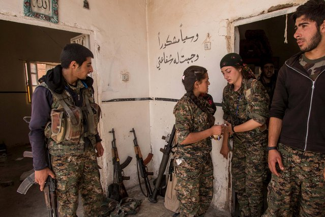 Armed Kurdish fighters from People's Protection Units (YPG) are seen in Tel al-Aghbish village, after the YPG said they retook control of the area from the Islamic State, May 21, 2015. (Photo by Rodi Said/Reuters)