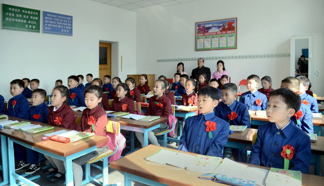 The new school year began in the DPRK with due ceremonies at schools. (Photo by Reuters/KCNA)