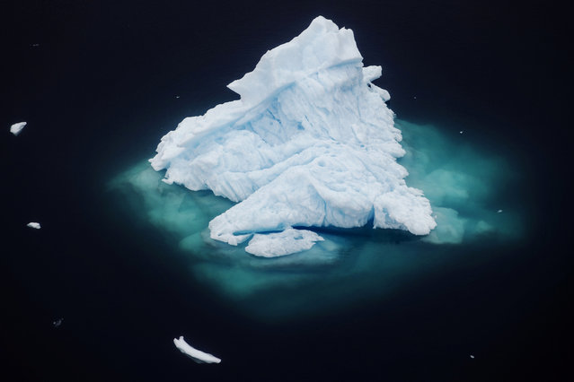An iceberg floats in a fjord near the town of Tasiilaq, Greenland, June 24, 2018. (Photo by Lucas Jackson/Reuters)