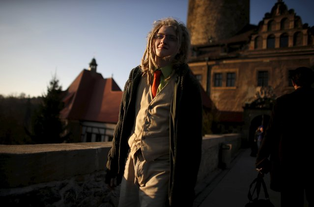 A participant smiles as he walks in front of the castle before the role play event at Czocha Castle in Sucha, west southern Poland April 9, 2015. (Photo by Kacper Pempel/Reuters)