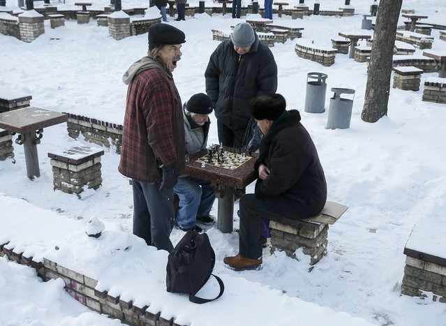 Men play chess on a winter day in a park in central Kiev, Ukraine, January 12, 2017. (Photo by Gleb Garanich/Reuters)
