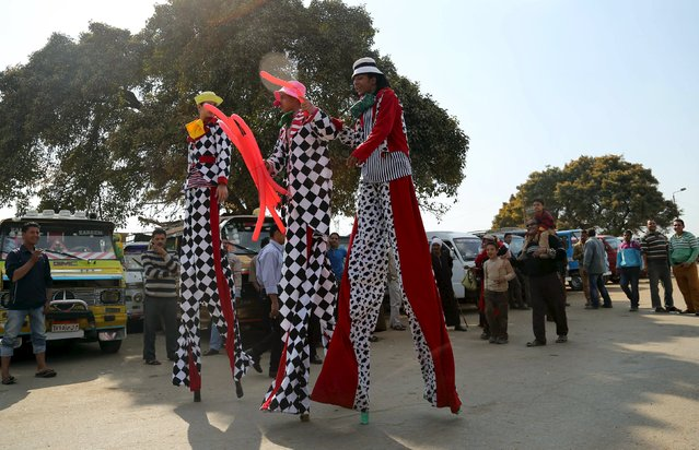 Men on stilts walk before they perfom in a street as Egyptians celebrate the spring holiday of Sham el Nessim in Cairo, April 13, 2015. (Photo by Asmaa Waguih/Reuters)