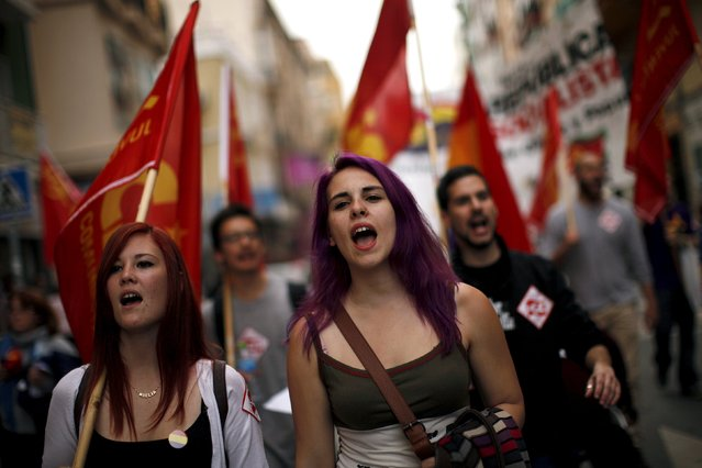 Republicans shout slogans during a demonstration to mark the 84th anniversary of Spain's Second Republic in Malaga, southern Spain, April 14, 2015. Spain celebrates today the 84th anniversary of the proclamation of the second Spanish Republic, which was overthrown by dictator Francisco Franco in a three-year civil war that claimed half a million lives. (Photo by Jon Nazca/Reuters)