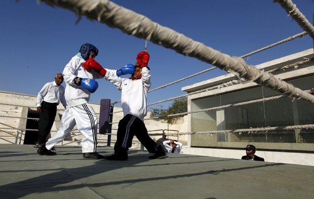 Tabia (L), 12, fights against Aamna, 11, during the Sindh Junior Sports Association Boxing Tournament in Karachi, Pakistan February 21, 2016. (Photo by Akhtar Soomro/Reuters)