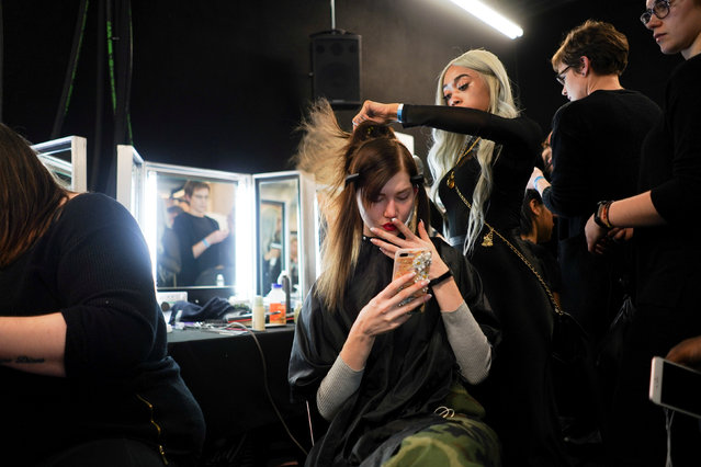 A model prepares backstage of the Marta Jakubowski show during London Fashion Week Women's A/W19 in London, Britain February 15, 2019. (Photo by Henry Nicholls/Reuters)