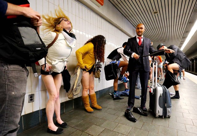 Participants begin to shed their pants for the No Pants Subway Ride at the Civic Center station of MARTA in Atlanta. (Photo by Curtis Compton/Atlanta Journal-Constitution)