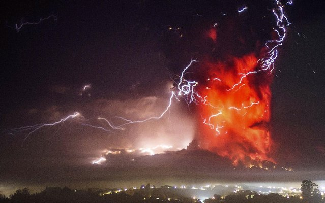 The Calbuco volcano erupts near Puerto Varas, Chile, Thursday, April 23, 2015. The volcano erupted Wednesday for the first time in more than 42 years, billowing a huge ash cloud over a sparsely populated, mountainous area in southern Chile, and is considered one of the top three most potentially dangerous among Chile's 90 active volcanos. (Photo by David Cortes Serey/AP Photo/Agencia Uno)