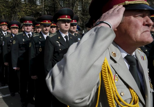 Ukrainian army officers attend a graduation ceremony at the National University of Defence of Ukraine in Kiev, April 24, 2015. (Photo by Gleb Garanich/Reuters)