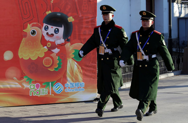 Paramilitary police officers patrol at the Daguanyuan park as the Chinese Lunar New Year, which welcomes the Year of the Rooster, is celebrated in Beijing, China January 30, 2017. (Photo by Jason Lee/Reuters)