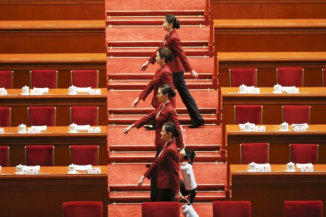 Attendants serve tea ahead of the third plenary session of the National People's Congress (NPC) at the Great Hall of the People, in Beijing, China, March 13, 2016. (Photo by Kim Kyung-hoon/Reuters)