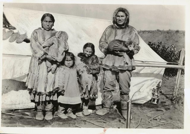 An Eskimo family living near the Mackenzie River, Canada. (Photo by Bettmann Collection)