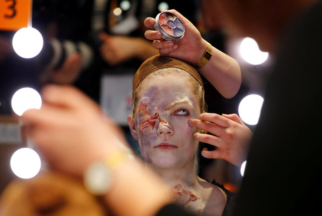 "A model is made up as ""Queen Elisabeth"" by Janika Kreutzer of the Hasso von Hugo makeup artist school in Berlin to win the the German make-up artist championships in Duesseldorf, Germany, March 31, 2019. (Photo by Wolfgang Rattay/Reuters)"