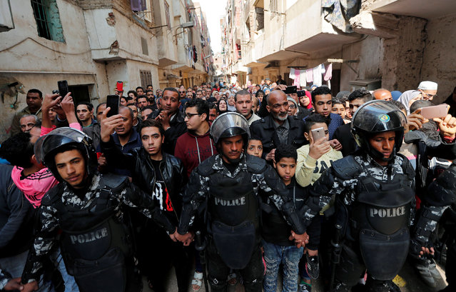 Policemen and people take part in the funeral of Egyptian police officer Mahmoud Abou El Yazied who was killed in a blast, in Cairo, Egypt on February 19, 2019. (Photo by Amr Abdallah Dalsh/Reuters)