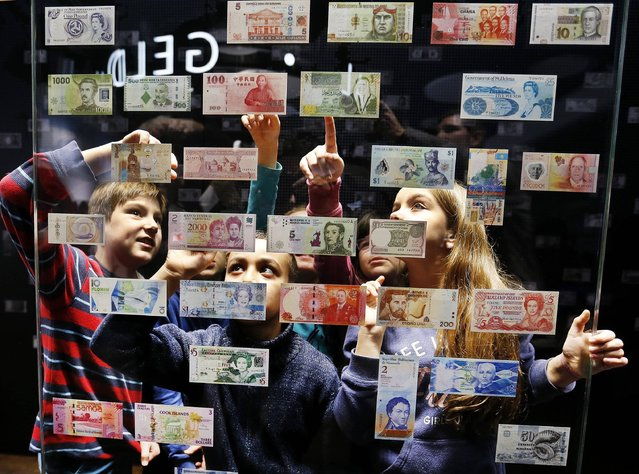 Children look at bank notes from all over the world in the Money Museum in Frankfurt, Germany, Thursday, December 15, 2016. The museum was reopened after two years of renovation. (Photo by Michael Probst/AP Photo)