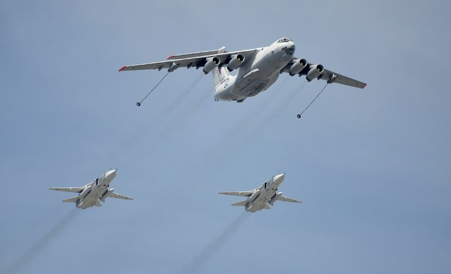 An Ilyushin Il-78 Midas air force tanker and Sukhoi Su-24 Fencer tactical bombers fly over the Red Square during the Victory Day parade in Moscow, Russia, May 9, 2015. (Photo by Reuters/Host Photo Agency/RIA Novosti)