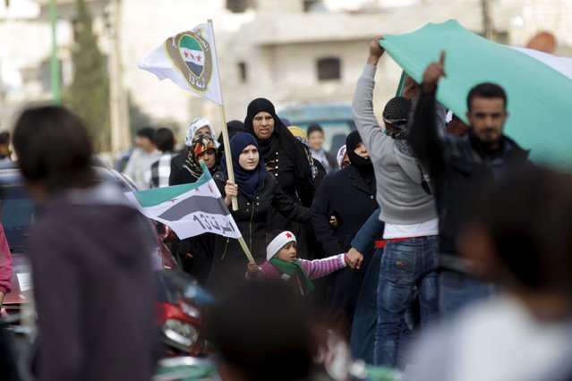 Women carry Free Syrian Army flags while attending an anti-government protest in Maarat al-Numan, south of Idlib, Syria March 18, 2016. (Photo by Khalil Ashawi/Reuters)