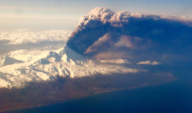 In this Sunday, March 27, 2016, Pavlof Volcano, one of Alaska's most active volcanoes, erupts, sending a plume of volcanic ash into the air. The Alaska Volcano Observatory says activity continued Monday. Pavlof Volcano is 625 miles southwest of Anchorage on the Alaska Peninsula, the finger of land that sticks out from mainland Alaska toward the Aleutian Islands. (Photo by Colt Snapp via AP Photo)