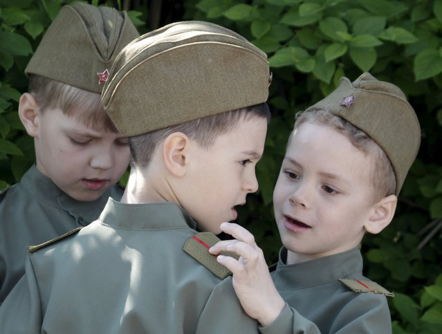 Boys dressed in a historical military uniform attend the so-called parade of children's troops in Rostov-on-Don, southern Russia, May 14, 2015. (Photo by Eduard Korniyenko/Reuters)