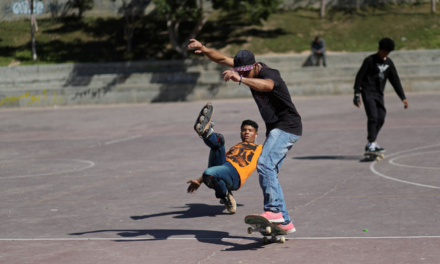Members of Gaza Skating Team, Mohammad Al-Sawalhe, 23, and Mustafa Sarhan, 19, practice their rollerblading and skating skills in Gaza City March 10, 2019. (Photo by Mohammed Salem/Reuters)