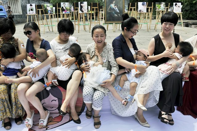 Women breastfeed their children during an event to promote breast feeding in Fuzhou, Fujian province, China, May 16, 2015. (Photo by Reuters/Stringer)