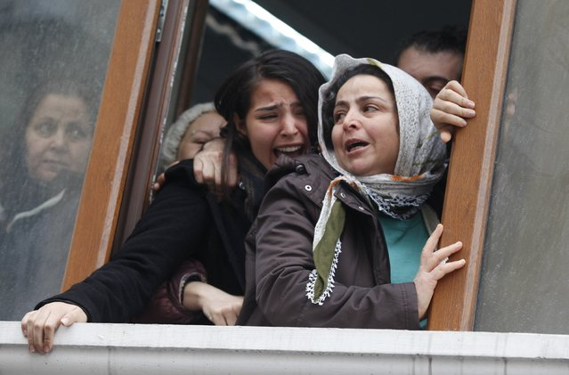 Berkin Elvan's sister Ozge (C) reacts as his coffin approaches the Okmeydani cemevi, an Alevi place of worship, in Istanbul March 11, 2014. Police and protesters clashed in Turkey's two biggest cities on Tuesday following the death of the 15-year-old boy who suffered a head injury during anti-government demonstrations last summer. (Photo by Osman Orsal/Reuters)