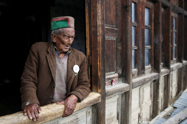 Shyam Saran Negi, 102, independent India's first voter who has participated in all elections since 1951, looks out from his house ahead of the final phase of the general election, in Kalpa, India, May 18, 2019. (Photo by Cheena Kapoor/Reuters)