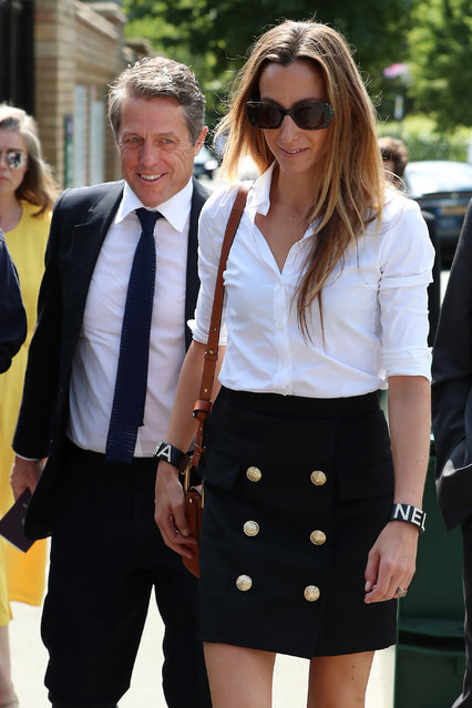 Hugh Grant and Anna Eberstein attend day 11 of the Mens semi-finals at the Wimbledon 2019 Tennis Championships at All England Lawn Tennis and Croquet Club on July 12, 2019 in London, England. (Photo by Neil Mockford/GC Images)