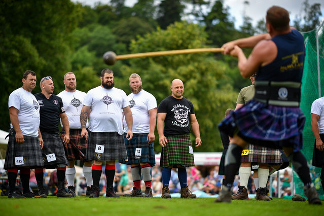 Heavy weight competitors take part at Inveraray Highland Games on July 16, 2019 in Inverarary, Scotland. The Games celebrate Scottish culture and heritage with field and track events, piping, highland dancing competitions and heavy events including the world championships for tossing the caber. (Photo by Jeff J. Mitchell/Getty Images)