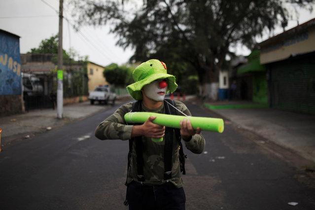 A demonstrator participates in the May Day march in San Salvador, El Salvador May 1, 2016. (Photo by Jose Cabezas/Reuters)